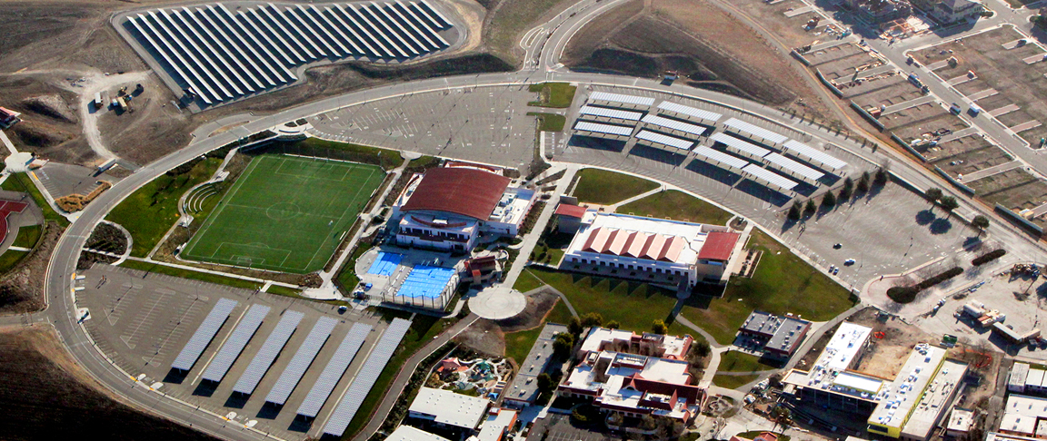 Aerial view of education campus's solar PV rooftop and carport systems