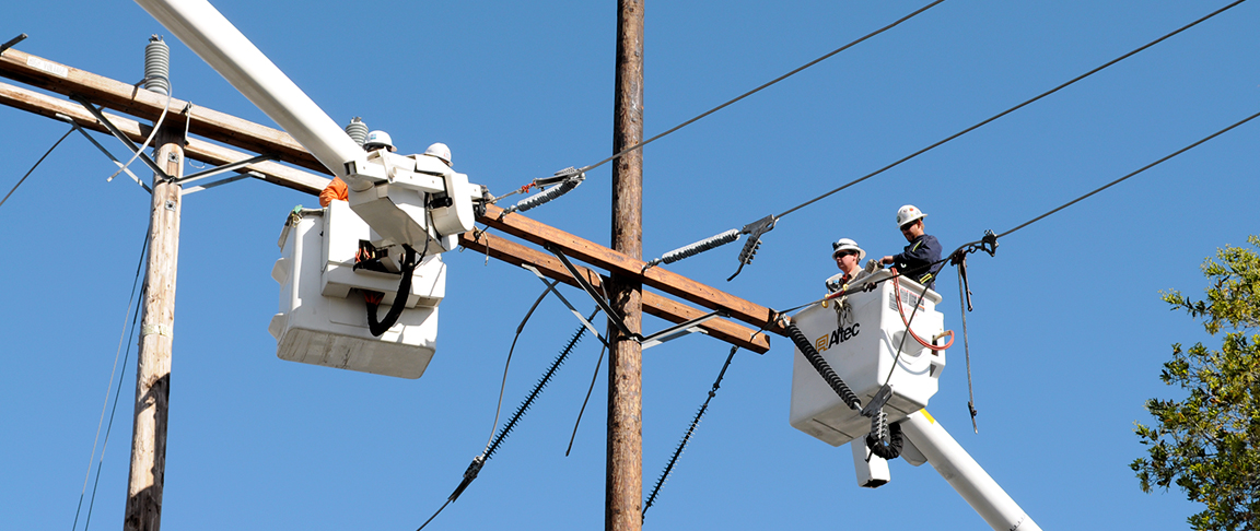 Utility linemen at the project work at great heights to complete the distribution circuit upgrade