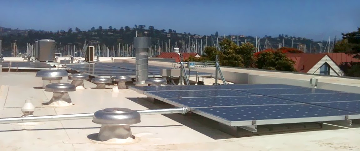Rooftop mount solar PV panels alongside a view of the nearby marina