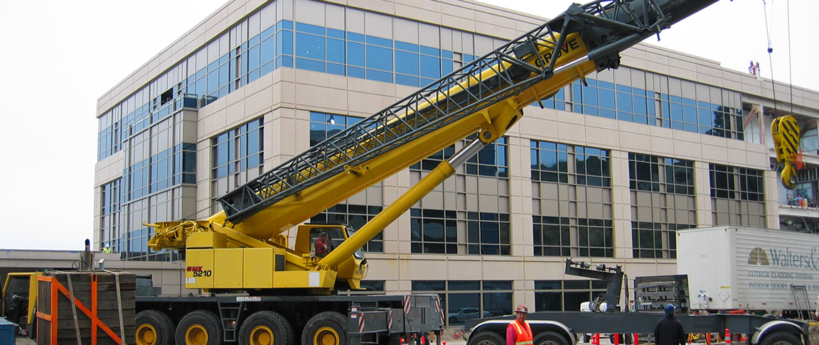 Cranes assist the crew to get the biotech commercial campus project completed on time
