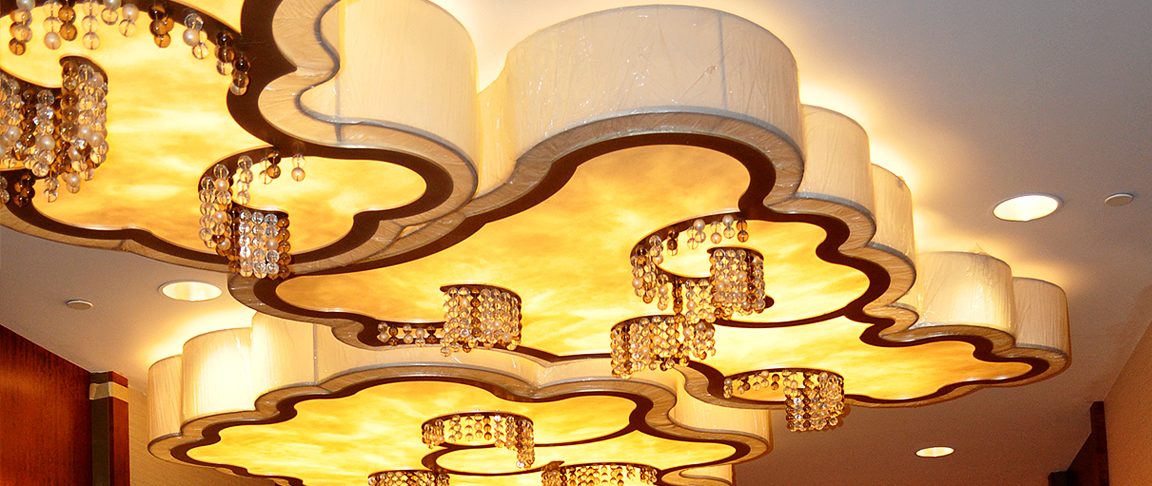 Intricate light fixture adds glamour to the meeting/ballroom space at the Hilton