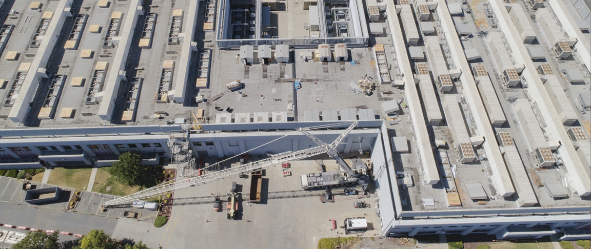 Drone photo of data center facility with crane visible on the ground.